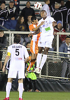 Kupono Low #3 Of the Carolina Railhawks goes up for a header with Chris Nurse #8 of the Puerto Rico Islanders during the second leg of the USSF-D2 championship match at WakeMed Soccer Park, in Cary, North Carolina on October 30 2010. The game ended 1-1, Puerto Rico won on overall goals 3-1.