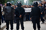 Police formed a line in front of protesters in downtown Tunis, Tunisia, Jan. 18, 2011. The Tunisian police and army struggled to maintain order in the capital, as thousands of protesters once again filled the streets.