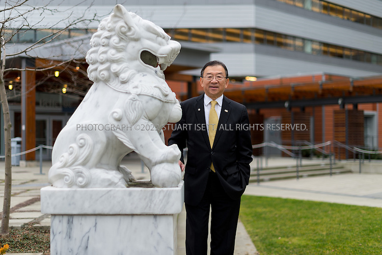 2/13/2013--Bellevue, WA, USA..Hong Kong-born Conrad Lee, a member of Bellevue's city council since 1994 and its mayor since early last year, posing by a lion statue on the city hall's grounds. Conrad Lee was an early adopter of the immigrant suburban ethos. He came to the States from Hong Kong in 1958, one in the mid-century ?forgotten wave? of Chinese immigrants, moved to Seattle in 1962, and became an engineer at Boeing. In 1967 he crossed the lake to Bellevue and never left. In 1995, he was elected to Bellevue's city council. Today, he is its mayor...©2013 Stuart Isett. All rights reserved.