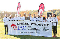 The UW-Lacrosse Women's Cross Country team poses with the championship banner after winning the WIAC Championship team title Saturday November 2, 2013, at Kilkarney Golf Course in River Falls with 34 points.<br /> <br /> Kathy M Helgeson/UWRF Communications