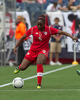 Canadian player Robyn Gayle (5) attempts to control the ball. In an international friendly, Canada defeated Brasil, 2-1, at Gillette Stadium on March 24, 2012.