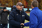 14 November 2014: UNC assistant coach Bill Palladino (left) shakes hands with SDSU head coach Lang Wedemeyer (right). The University of North Carolina Tar Heels hosted the South Dakota State University Jackrabbits at Fetzer Field in Chapel Hill, NC in a 2014 NCAA Division I Women's Soccer Tournament First Round match. UNC won the game 2-0.