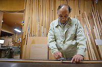 """Kenetsu Mishina, Presidents of Iwayado Tansu Seisakujo, making a """"sao"""" blueprint for a chest of drawers, Oshu City, Iwate Prefecture, Japan, July 18, 2013. Iwayado Tansu chests of drawers have been made in the city of Oshu since the 1780s. They are noted for their fine lacquer finish and finely-wrought metalwork fittings."""