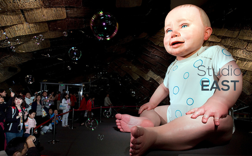 Visitors gather in front of a huge animated baby mannequin displayed in the Spanish pavilion at the site of Shanghai World Expo 2010, in Shanghai, China, on May 10, 2010. Photo by Lucas Schifres/Pictobank