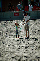 Saturday, September 20 2008.  Pacific Beach, San Diego, CA, USA: PB Resident Mike Borders and his daughter Tara (3) search for trash on an almost pristine Pacific Beach as part  of the California Coastal Cleanup Day.  Volunteers in the annual Coastal Cleanup found little to clean up beyond cigarette butts on San Diego's Alcohol free beaches.