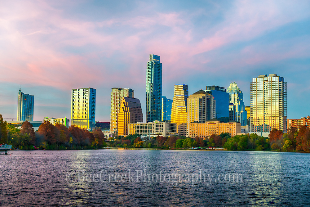 Downtown Austin skyline from across Ladybird Lake as the sun set left this nice golden glow on the high-rise buildings.  Austin is a very modern city with a lot of thing going on so we are always trying to capture a photo that reflects the beauty of this city.  Today we were especially please with the colors of the sky and the glow on the buildings over the city for a spectacular city view.   The skyline has some of our tallest skyscrapers in with the Austonian, the Austin 360 Condos, and the Frost which was one of the tallest for many years.  The Marriot a new downtown hotel is now partially blocking the view of the Frost from this angle but it is still a nice view. The Austin skyline is getting crowded and there are many new building that are being built that will be added along the lake area so it will change again in the near future.