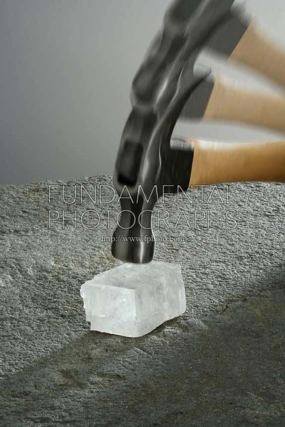 BREAKING CALCITE WITH A HAMMER<br /> (1 of 2 - Variations Available)<br /> Iceland Spar is Clear, Cleaved Calcite<br /> Also known as Optical Calcite, it displays Calcite's classic cleavage form - the rhombohedron, and is the most stable polymorph of calcium carbonate. (CaCO3)