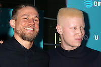 "HOLLYWOOD, CA - JULY 7: Charlie Hunnam, Shaun Ross at the ""Equals"" Premiere at the ArcLight Theater in Hollywood, California on July 7, 2016. Credit: David Edwards/MediaPunch"