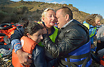 Lisbeth Svendsen, a volunteer from Norway, gets a hug from Nabil Minas as she hugs his wife and daughter on a beach near Molyvos, on the Greek island of Lesbos, on October 30, 2015. The Syrian refugees were on a boat that traveled to Lesbos from Turkey, provided by Turkish traffickers to whom the refugees paid huge sums. Svendsen is one of hundreds of volunteers on the island who receive the refugees and provide them with warm clothing and medical care before they continue their journey toward western Europe.<br /> <br /> When Minas disembarked from the boat, he fell on his face and kissed the ground. A Christian, he crossed himself and covered his face with his hands, weeping with joy.