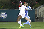 08 November 2013: Florida State's Jamia Fields (4) and North Carolina's Megan Brigman (3). The Florida State University Seminoles played the University of North Carolina Tar Heels at WakeMed Stadium in Cary, North Carolina in a 2013 NCAA Division I Women's Soccer match and the semifinals of the Atlantic Coast Conference tournament. Florida State won the game 2-1 in overtime.