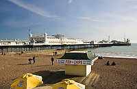 Fish and chip shop on beach by Brighton Pier, England, United Kingdom