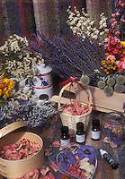 Rose petals, lavender, dried flowers, essential oils, oil burner, baskets, ingredients for making scented potpourri &amp; aromatherapy products