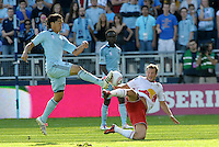 Sporting KC midfielder Roger Espinoza (15) challenges Red Bulls midfielder Teemu Tainio (2) for the ball... Sporting Kansas City defeated New York Red Bulls 2-1 at LIVESTRONG Sporting Park, Kansas City, Kansas.