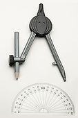 Stock photo drafting compass with pencil and a protractor