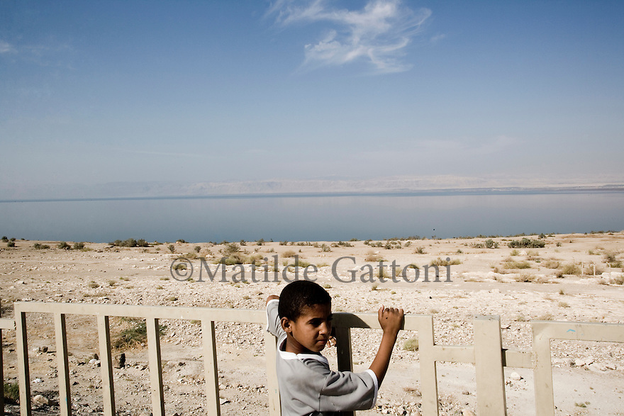 JORDAN - LITTLE BOY STANDING NEXT TO THE DEAD SEA