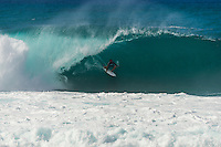PIPELINE, Oahu/Hawaii (Saturday, December 14, 2013) Joel Parkinson (AUS) . - Kelly Slater (USA), 41, has won his 7th Billabong Pipe Masters in Memory of Andy Irons after a day of incredible 10-to-15 foot (three to four metre) waves at Pipeline today. Slater defeated John John Florence (HAW), 21, in a hard-fought, 35-minute Final that ended with less than half-a-point separating the two. The runner-up finish for Florence saw him crowned 2013 Vans Triple Crown of Surfing champion.<br /> <br /> The final day of the Billabong Pipe Masters capped off the 2013 ASP World Championship Tour (WCT) season in fine style, with epic conditions providing the ideal backdrop for the crowning of Mick Fanning (AUS), 32, as the ASP World Champion. It also finalized the ASP Top 34 roster for 2014. Fanning finished third overall, defeated by Florence in their Semifinal.<br /> With tens of thousands packing the beach at Pipeline, and the gravitas of Slater&rsquo;s 56th elite tour victory apparent, the greatest athlete the sport has ever produced was emotional on the final day of 2013.<br /> <br /> Fanning&rsquo;s road to the 2013 ASP World Title was nothing short of spectacular on the final day of competition. Finding himself behind during both his Round 5 and Quarterfinals bouts, the iron-nerved Australian nailed huge Pipeline scores in both occasions to take the heat wins and his third world surfing crown.<br /> <br /> &ldquo;I&rsquo;ve never put myself in the same circles as Tom Curren and Andy Irons,&rdquo; Fanning said. &ldquo;Tom (Curren) is such an enigma and was so instrumental to injecting style into our sport. Andy (Irons)&hellip;what hasn&rsquo;t been said about Andy? He was such a legend and he was such a good friend. I&rsquo;m honored to be a part of this group. I was happy with one title and I was overwhelmed with two. With three? I don&rsquo;t have words for that.&rdquo;<br /> <br /> Today marked John John Florence&rsquo;s second Vans Triple Crown Title, but his runner-up i