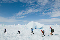 Glaciologists hike across the Greenland Ice Sheet.