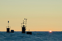 Instrument towers on the Greenland ice sheet measure conditions year round.