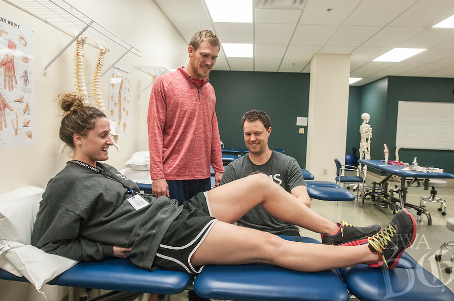 NWA Democrat-Gazette/ANTHONY REYES &bull; @NWATONYR<br /> Scott Van Camp (right) demonstrates how to measure range of motion on Gracie Frizzell as Kyle Roliard, all University of Arkansas for Medical Sciences physical therapy students, looks on Thursday, Dec. 10, 2015 at the school in Fayetteville. The school is finishing its first semester in Fayetteville.