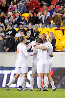 Tristan Watson (22) of the Cincinnati Bearcats celebrates scoring a goal with teammates, The Providence Friars defeated the Cincinnati Bearcats 2-1 during the semi-finals of the Big East Men's Soccer Championship at Red Bull Arena in Harrison, NJ, on November 12, 2010.
