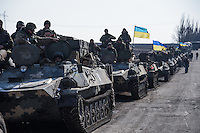Ukrainian military preparing to move during the withdrawal of heavy weapons. Near Artemovsk, Eastern Ukraine. Friday, 27 February 2015.