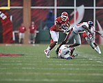Arkansas wide receiver Greg Childs (85) is tackled by Ole Miss safety Johnny Brown (20) and Ole Miss cornerback Jeremy McGee (6) at Reynolds Razorback Stadium in Fayetteville, Ark. on Saturday, October 23, 2010.