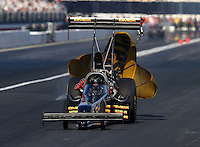 Nov 9, 2013; Pomona, CA, USA; NHRA top fuel dragster driver Troy Buff during qualifying for the Auto Club Finals at Auto Club Raceway at Pomona. Mandatory Credit: Mark J. Rebilas-