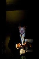 Kodak's Chief Marketing Officer Jeffrey Hayzlett (@JeffreyHayzlett) looks at his smartphone during the 140 Character conference in New York City, USA, 16 June 2009.