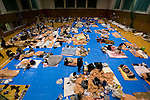 Around 300 people, many evacuated from villages and towns close to the Fukushima No. 1 Nuclear Power Plant, take shelter at an evacuation site inside a gymnasium about 30 km from the nuclear accident in Iwaki City, Fukushima, Japan on 12 March, 2011. Photographer: Robert Gilhooly