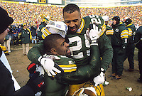 """Dorsey Levens congratulates Reggie White as the Green Bay Packers defeat the Carolina Panthers in the NFC Championship game at Lambeau Field and advance to the team's first return to the Super Bowl in 29 years. This was the first title game in Green Bay since the """"Ice Bowl"""" in 1967."""
