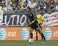 San Jose Earthquakes forward Alan Gordon (24) brings the ball forward.  In a Major League Soccer (MLS) match, the New England Revolution (white) defeated San Jose Earthquakes (black), 2-0, at Gillette Stadium on July 6, 2013.