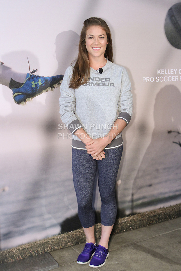 """Kelley O'Hara, Olympic gold medal winning Soccer player, posing during the Under Armour, """"I will what I want"""" global women's campaign launch, on July 31, 2014, in New York City."""