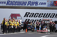 Jun. 2, 2013; Englishtown, NJ, USA: NHRA Safety Safari members and members for top fuel dragster driver Steve Torrence stand during the playing of the National Anthem during the Summer Nationals at Raceway Park. Mandatory Credit: Mark J. Rebilas-