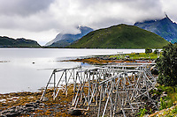 Norway, Lofoten. The fjord between Moskenesøya and Flakstadøya. The wooden constructions are used to dry fish.