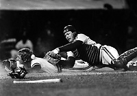 Oakland Athletics catcher Mike Heath slides into home with a inside the park Home Run. April 18, 1985.<br />