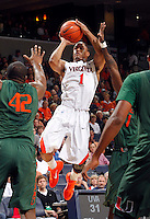 CHARLOTTESVILLE, VA- JANUARY 7: Jontel Evans #1 of the Virginia Cavaliers shoots between Miami Hurricane defenders during the game against the Miami Hurricanes on January 7, 2012 at the John Paul Jones Arena in Charlottesville, Virginia. Virginia defeated Miami 52-51. (Photo by Andrew Shurtleff/Getty Images) *** Local Caption ***