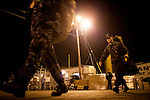 Navy medical personnel load relief supplies on board the USNS Comfort, a naval hospital ship, before its mission to help survivors of the earthquake in Haiti on Friday, January 15, 2010 in Baltimore, MD.