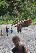 A grounded rusting ship, left by loggers, in the bay of Bain village in the Cape Orford logging concession (run by Rimbunan Hijau- Malaysian logging giants), in Bain, East New Britain Island, Papua New Guinea,  Friday 19th September 2008..