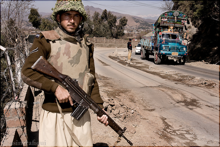Pakistani Army soldiers man a road check point in search of suspected Islamic militants who have been carrying out a bombing campaign against government and civilian targets.  nearly 30,000 soldiers have been bought to the region but the war against the militant continues relentlessly with little sign of them stopping their campaign
