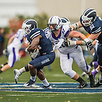 8 October 2016: Middlebury College Panther Running Back Diego Meritus, a Sophomore from Yarmouthport, MA, pulls away from Amherst College Defensive Lineman Paul Johnson, a Senior from Moorestown, NJ, at Alumni Stadium in Middlebury, Vermont. The Panthers edged out the Purple & While 27-26. Mandatory Credit: Ed Wolfstein Photo *** RAW (NEF) Image File Available ***