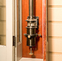 WALL MOUNTED MERCURY BAROMETER<br /> Measures Atmospheric Pressure<br /> At the bottom of the barometer is a pool of Mercury, which supplies the column with Mercury. The adjusting knob is used to adjust the surface of the mercury reservoir to the tip of the zeroing peg.