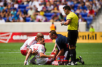 Brandon Barklage (25) of the New York Red Bulls is treated by a trainer. The New York Red Bulls defeated the Philadelphia Union 2-0 during a Major League Soccer (MLS) match at Red Bull Arena in Harrison, NJ, on July 21, 2012.