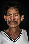 Tuna fisherman, Efren poses for a portrait at the Casa, the Tuna buying house in Puerto Princesa, Palawan in the Philippines. <br /> Photo: Sanjit Das/Panos for Greenpeace