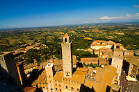 San Gimignano, Italy has several medieval towers that rise above its Tuscan hills.