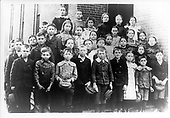 Abilene, Kansas - Undated File photo -- Dwight D. Eisenhower, 2nd from left in front row, with his fifth grade class in Abilene, Kansas circa 1900..Credit: U. S. Army Photo  via CNP