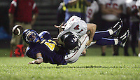 Western's Sam Schwoebel, left, funbles the ball while being tackled by Liberty's Trevor Cheek Friday night during the 2nd quarter of the game. Photo/The Daily Progress/Andrew Shurtleff