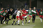12 December 2008: Graham Zusi (shirtless) of Maryland is joined by his teammates in celebrating Zusi's game winning goal.  The University of Maryland Terrapins defeated the St. John's University Red Storm 1-0 during the second sudden death overtime at Pizza Hut Park in Frisco, TX in an NCAA Division I Men's College Cup semifinal game.