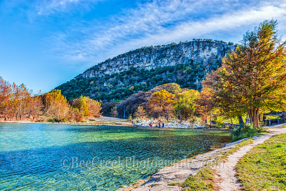 Old Baldy with these wonderful fall colors  from the cypress and maples against a backdrop of the emerald green waters of the Frio River and the blue sky and white clouds. You can see the crowd of people on the rocks below the dam enjoying this wonderful day.