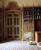 The tall double doors to the pharmacy are marbled in soft blues and greens and are surmounted by allegorical scenes of the four seasons - the work of Joseph-Guillaume Duplessis, a local surgeon who abandoned his medical career for art