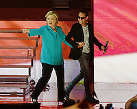 MIAMI FL - OCTOBER 29: Hillary Clinton and Marc Anthony on stage at the Jennifer Lopez Gets Loud for Hillary Clinton at GOTV Concert at The Bayfront Park Amphitheatre on October 29, 2016 in Miami, Florida. Credit: mpi04/MediaPunch